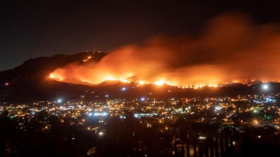 A long-exposure photo shows the Maria Fire as it races across a hillside in Santa Paula, California, on November 1.