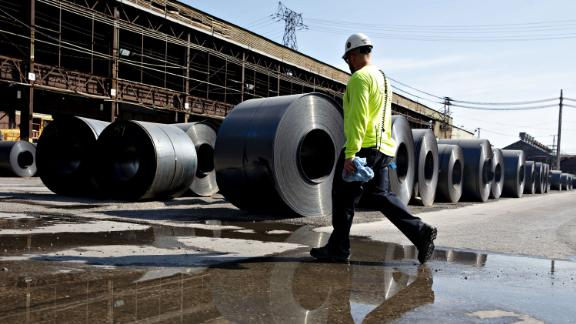 A worker walks past steel coils at the U.S. Steel Corp. Granite City Works facility in Granite City, Illinois, U.S., on Thursday, July 26, 2018. U.S. President Donald Trump celebrated U.S. Steel Corp