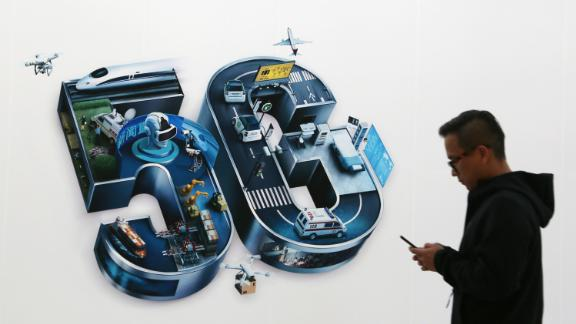 BEIJING, CHINA - OCTOBER 31: A man walks past a 5G sign on the opening day of PT Expo China 2019 at the China National Convention Center on October 31, 2019 in Beijing, China. China officially kicked off commercialization of 5G services on Thursday. China Mobile, China Unicom and China Telecom unveiled their monthly 5G plans with prices ranging from 128 yuan (about 18 U.S. dollars) to 599 yuan (about 85 U.S. dollars). (Photo by VCG/VCG via Getty Images)