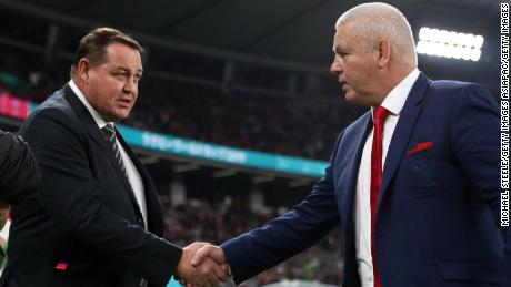 Steve Hansen (left), head coach of New Zealand, shakes hands with Warren Gatland (right), head coach of Wales, as the two legends of the game step down from their respective roles.
