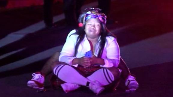 """Grabs from video show numerous emergency responders at the scene assisting with victims and loading patients into ambulances.  The video also shows at least two Injured attendees limping and needing assistance due to injuries.  A woman could also be seen sitting in the street crying.  The Contra Costa Sheriff's Office tweeted, Orinda Police Department and Contra Costa County Office of the Sheriff are working a multiple shooting in Orinda. Investigation is active."""" Police were investigating a Halloween night shooting involving multiple victims, authorities told CNN affiliate KPIX."""
