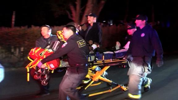 "Grabs from video show numerous emergency responders at the scene assisting with victims and loading patients into ambulances.  The video also shows at least two Injured attendees limping and needing assistance due to injuries.  A woman could also be seen sitting in the street crying.  The Contra Costa Sheriff's Office tweeted, Orinda Police Department and Contra Costa County Office of the Sheriff are working a multiple shooting in Orinda. Investigation is active."" Police were investigating a Halloween night shooting involving multiple victims, authorities told CNN affiliate KPIX."