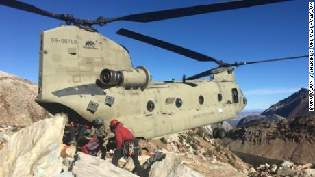 Because of the difficult terrain and falling rocks, a Search and Rescue team had to use a helicopter to get the women's bodies off the mountain.