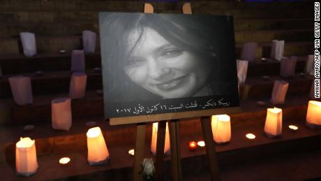 A portrait of British embassy worker Rebecca Dykes at a candlelit vigil.