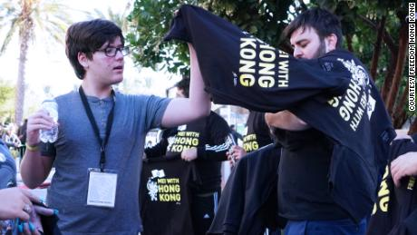 Protesters hand out free shirts outside BlizzCon, in Anaheim, California, on Friday.