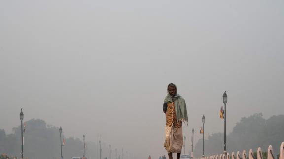 A man walks along a street as a heavy smog hits New Delhi on November 1, 2019.
