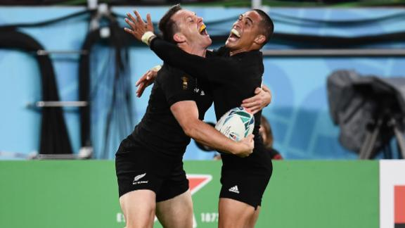 New Zealand's wing Ben Smith (L)  celebrates with scrumhalf Aaron Smith after scoring a try  during the Japan 2019 Rugby World Cup bronze final match against Wales. The All Blacks ran out comfortable 40-17 winners.