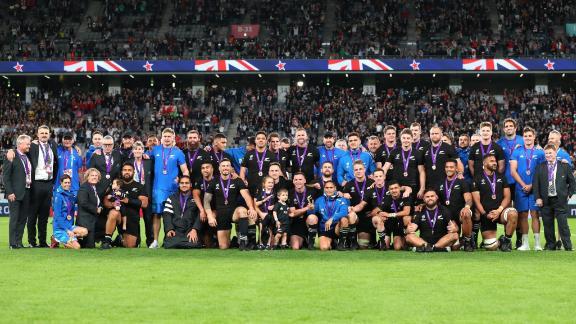 The All Blacks celebrate their bronze medal success.