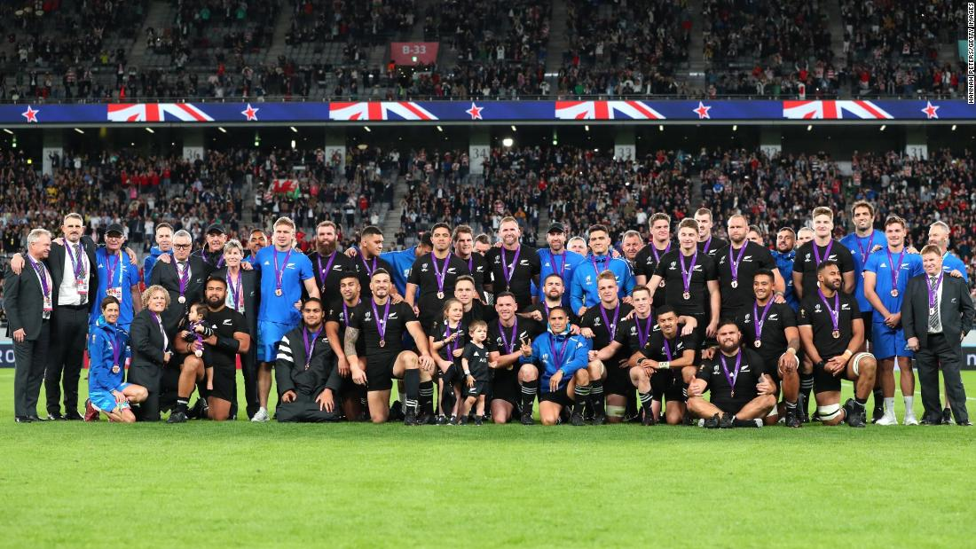 The All Blacks celebrate their bronze medal success.