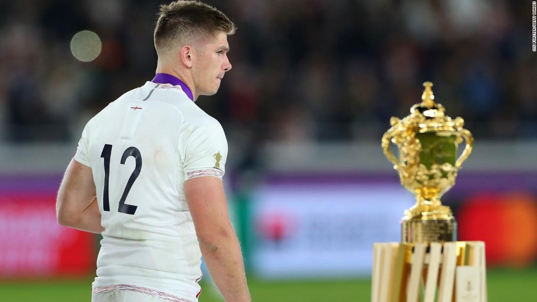 Owen Farrell of England walks past the Web Ellis trophy. South Africa were deserved victors, winning 32-12.
