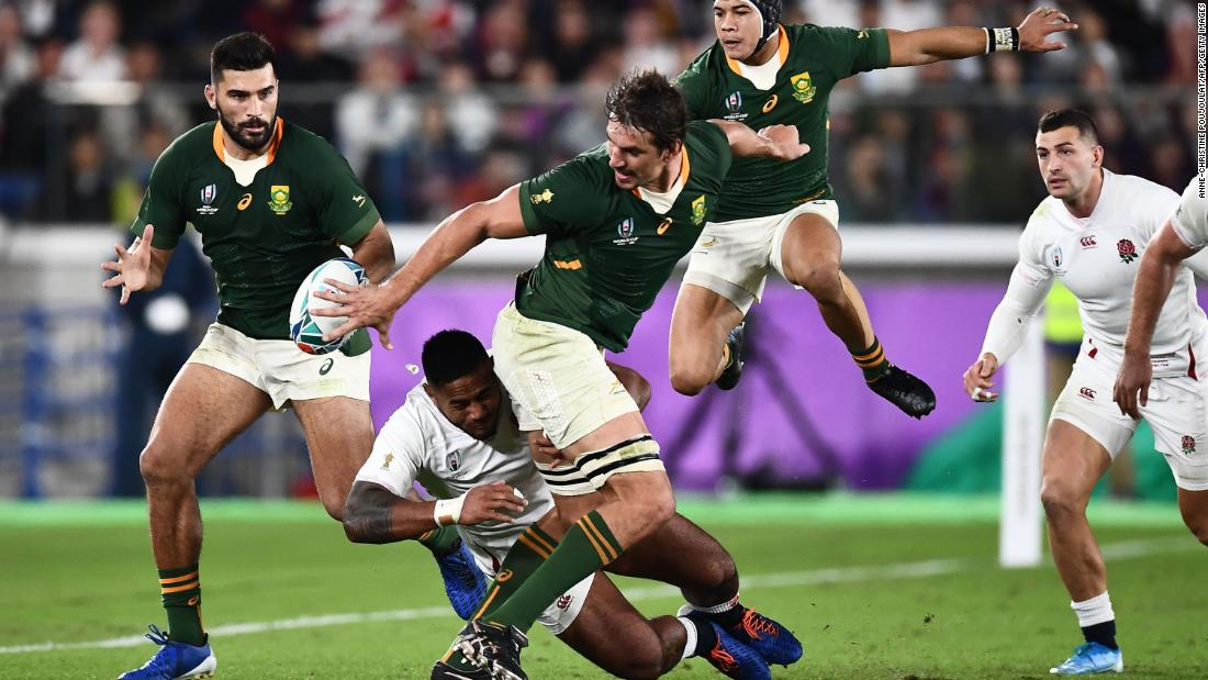 South Africa's lock Eben Etzebeth (C) passes the ball to South Africa's centre Damian De Allende (L). The win over England gave the Springboks their third World Cup title.
