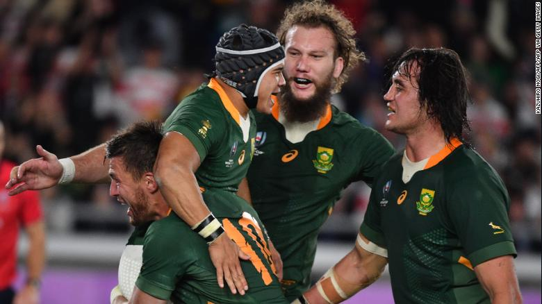 South Africa's wing Cheslin Kolbe (C) is congratulated by teammates after scoring a try against England.