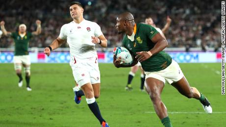 Makazole Mapimpi of South Africa breaks through to score his team's first try during the Rugby World Cup final.