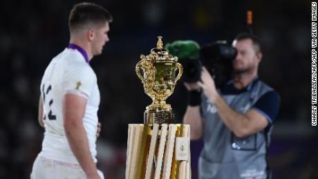 England's centre Owen Farrell walks past the World Cup trophy after losing the 2019 Rugby World Cup final.