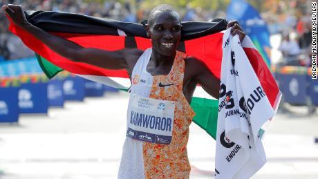 Kenya Jeffrey Kamvor celebrates winning the NYC Marathon on Sunday.