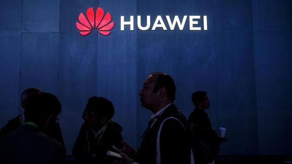 Attendees walk past signage displayed outside the Huawei Technologies Co. booth at the 2019 Consumer Electronics Show (CES) in Las Vegas, Nevada, U.S., on Wednesday, Jan. 9, 2019. Dozens of companies will give presentations at the event, where attendance is expected to top 180,000, with the trade war between the U.S. and China as well as Apple's sales woes looming over the gathering. Photographer: Patrick T. Fallon/Bloomberg via Getty Images