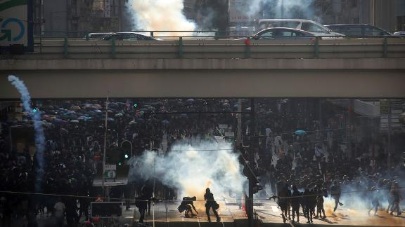 Thousands of black-clad masked protesters streamed into Hong Kong