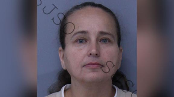 Tina Scee was arrested after authorities allege she used her adoptive son as bait in an adoption scam.