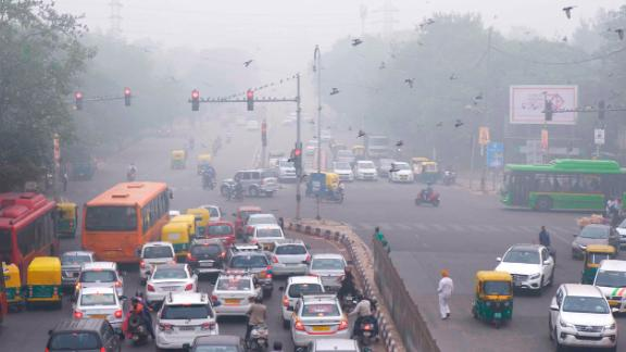 "In this Sunday, Nov. 3, 2019, photo, vehicles wait at a crossing amidst morning smog in New Delhi, India. Authorities in New Delhi are restricting the use of private vehicles on the roads under an ""odd-even"" scheme based on license plates to control vehicular pollution as the national capital continues to gasp under toxic smog. (AP Photo/Manish Swarup)"