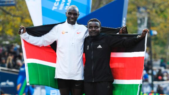 NEW YORK, NEW YORK - NOVEMBER 03: Geoffrey Kamworor and Joyciline Jepkosgei of Kenya pose with the Kenyan flag after winning the Mens' and Womens' Division of the 2019 TCS New York City Marathon on November 03, 2019 in New York City. (Photo by Sarah Stier/Getty Images)