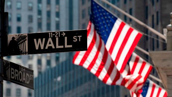 The US flag flies outside the New York Stock Exchange on March 11, 2019 in New York. - The benchmark Dow Jones Industrial Average was flat midmorning, recovering from steep early losses driven by tumbling shares in US aviation giant Boeing following Sunday's fatal crash in Ethiopia. Around 1430, Boeing shares were down 8.4 percent at $387.01, up from the steeper plunge before the market open following the fatal crash of the Ethiopian Airlines Flight ET302 -- the second involving a Boeing 737 Max 8 in five months. (Photo by Don Emmert / AFP)        (Photo credit should read DON EMMERT/AFP via Getty Images)