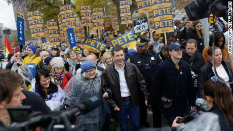 Democratic presidential candidate, South Bend, Indiana, Mayor Pete Boutigig walks with her husband, Shasten Boutigig, before the Iowa Democratic Party Liberty & amp; Justice Day Celebration on November 1, 2019 in Des Moines, Iowa.