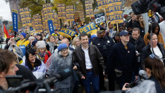 Democratic presidential candidate, South Bend, Indiana, Mayor Pete Buttigieg walks with his husband Chasten Buttigieg before the Iowa Democratic Party Liberty & Justice Celebration on November 1, 2019 in Des Moines, Iowa.