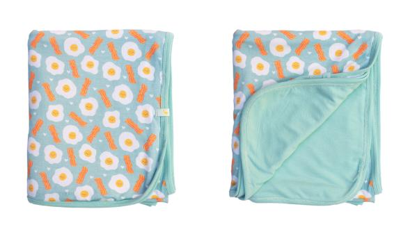 Clover Signature Bacon and Eggs Baby Blanket ($30; cloverbabyandkids.com): Soft and charmingly quirky, this big blanket will keep wee ones cozy on stroller rides now and live on as a lovey later.