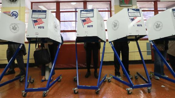 Voters cast their ballots at voting booths on November 8, 2016 in New York, United States.