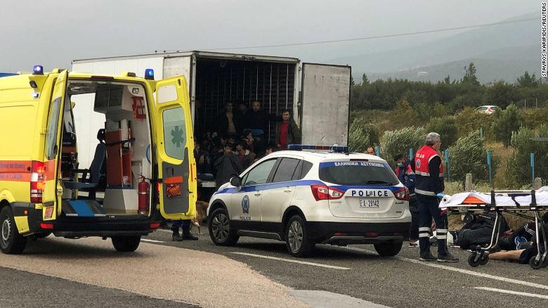 People are seen inside a refrigerated truck found by the police near Xanthi, Greece.