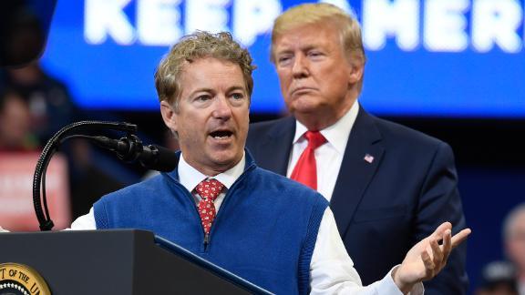 President Donald Trump listens as Sen. Rand Paul, R-Ky., speaks during a campaign rally in, Lexington, Ky., Monday, Nov. 4, 2019.  (AP Photo/Susan Walsh)