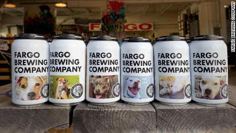 A North Dakota brewery is featuring dogs up for adoption on its beer cans
