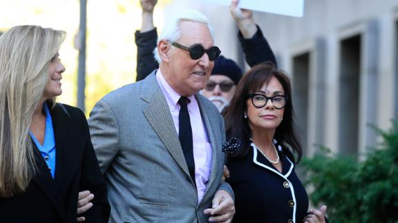 Roger Stone, center, with his wife, Nydia Stone, right, arrive at the federal court in Washington, Tuesday, November 5. Stone, a longtime Republican provocateur and former confidant of President Donald Trump, goes on trial over charges related to his alleged efforts to exploit the Russian-hacked Hillary Clinton emails for political gain.