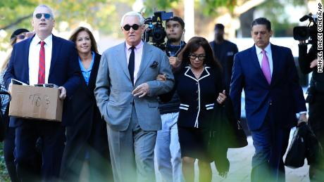 Roger Stone, center, with his wife, Nydia Stone, second from right, arrive at the federal court in Washington, Tuesday, November 5. Stone, a longtime Republican provocateur and former confidant of President Donald Trump, goes on trial over charges related to his alleged efforts to exploit the Russian-hacked Hillary Clinton emails for political gain.