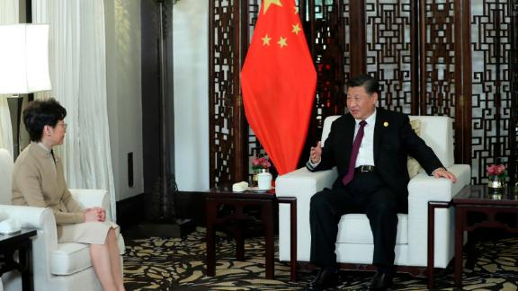 In this Monday, Nov. 4, 2019, photo released by China's Xinhua News Agency, Chinese President Xi Jinping, right, talks with Hong Kong Chief Executive Carrie Lam during a meeting in Shanghai, China. Lam is here for the second China International Import Expo (CIIE). (Ju Peng/Xinhua via AP)