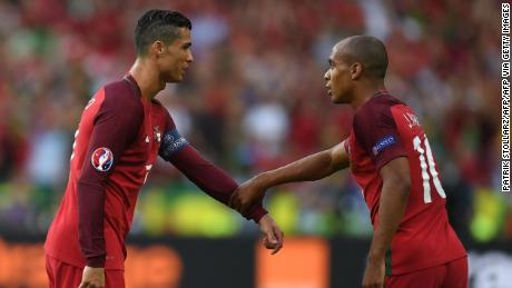 Ronaldo (left) talks with Mario (right) during the Euro 2016 final against France.