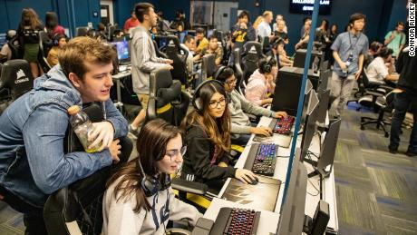 Students at UC Berkeley play games with Twitch streamer Jayden Diaz during a Halloween event.