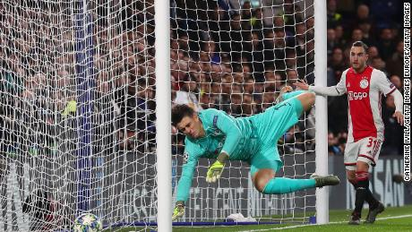 Kepa Arrizabalaga scores an unfortunate own goal.