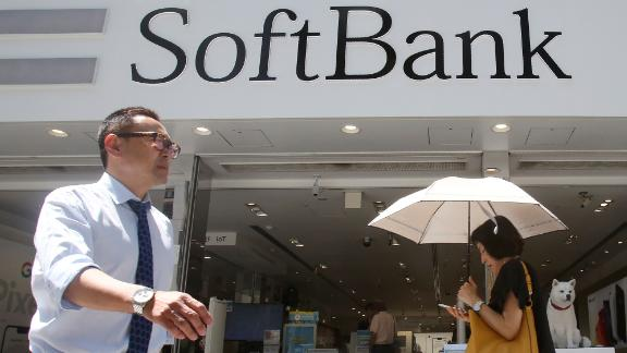 People walk by a SoftBank shop in Tokyo, Wednesday, Aug. 7, 2019.
