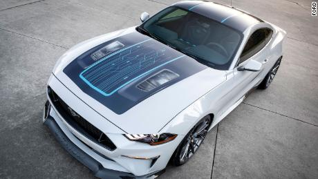 The Ford Mustang Lithium has two clear panels in the bonnet to give a view of the parts below.