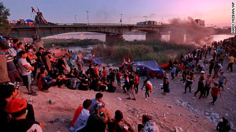 Protesters stage a sit-in around a bridge leading to the Green Zone government areas in Baghdad on  November 5.