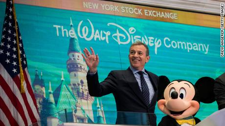 Bob Iger and Mickey Mouse look on before ringing the opening bell at the New York Stock Exchange in November 2017, marking the company's 60th anniversary as a publicly-traded company. (Drew Angerer/Getty Images)