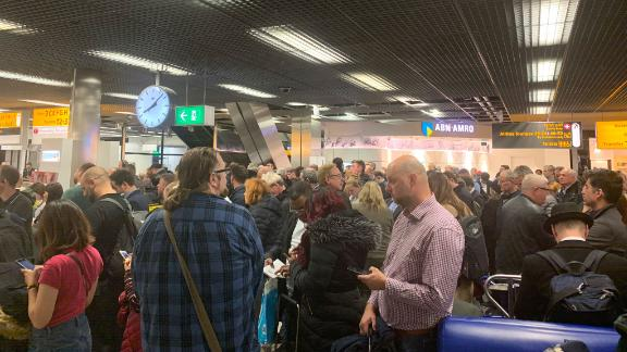 Mark Crompton shared a photo from Amsterdam's Schiphol Airport of large crowds and confusion amid the suspicious situation at the airport.