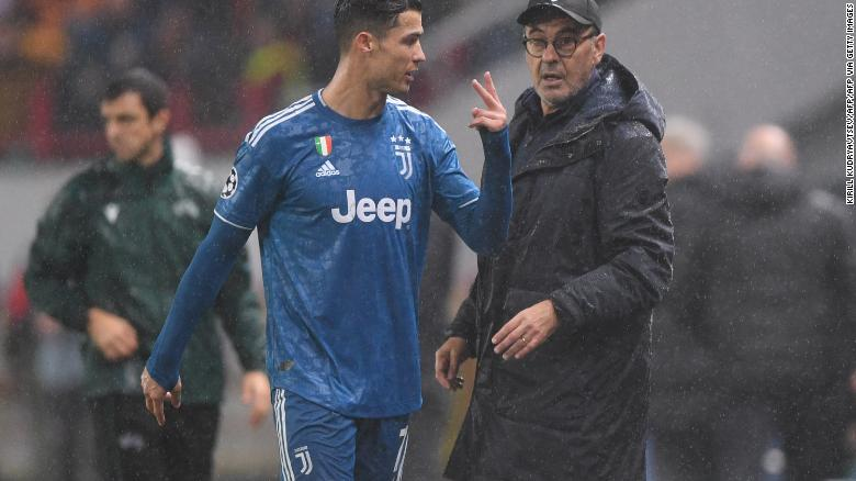 Juventus' Portuguese forward Cristiano Ronaldo and Juventus' Italian coach Maurizio Sarri during the Champions League match against Lokomotiv Moscow.
