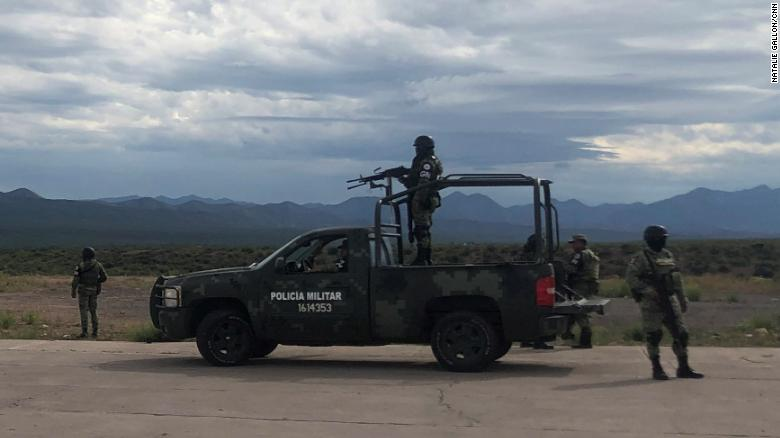 Mexican security personnel stand guard outside Bavispe -- the closest town to La Mora -- on Wednesday.