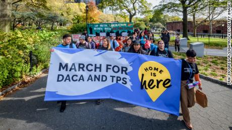 Eliana Fernández (holding banner, second from left) and other demonstrators are on a 230-mile march from New York to Washington. Their journey will end Tuesday at the Supreme Court.