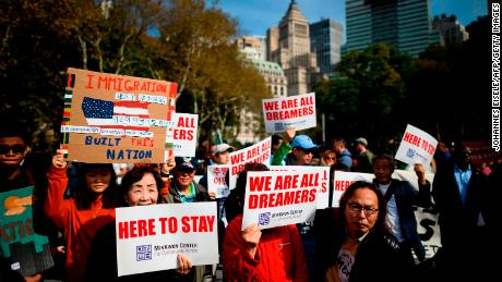 "People take part in a kick-off rally of the ""Home Is Here"" March for DACA and TPS on October 26 in New York City."