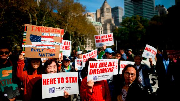 """People take part in a kick-off rally of the """"Home Is Here"""" March for DACA and TPS on October 26 in New York City."""