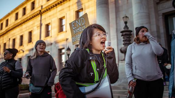 Carolina Fung Feng, 30, leads protesters in a chant in Media, Pennsylvania. Fung Feng is among the DACA recipients who are suing the government over the administration's decision to end the program.