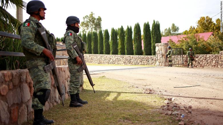 Soldiers keep watch outside the properties of Mexican-American Mormons in Bavispe and LaMora on November 6, 2019.